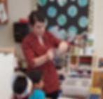 Alison Egitto teaching preschoolers how to make paper