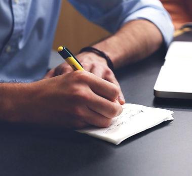 man-writing-in-notebook.jpg