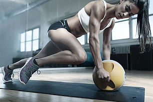 Muscular Woman Doing Intense Core Workou