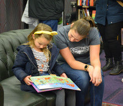 Volunteer reading with child