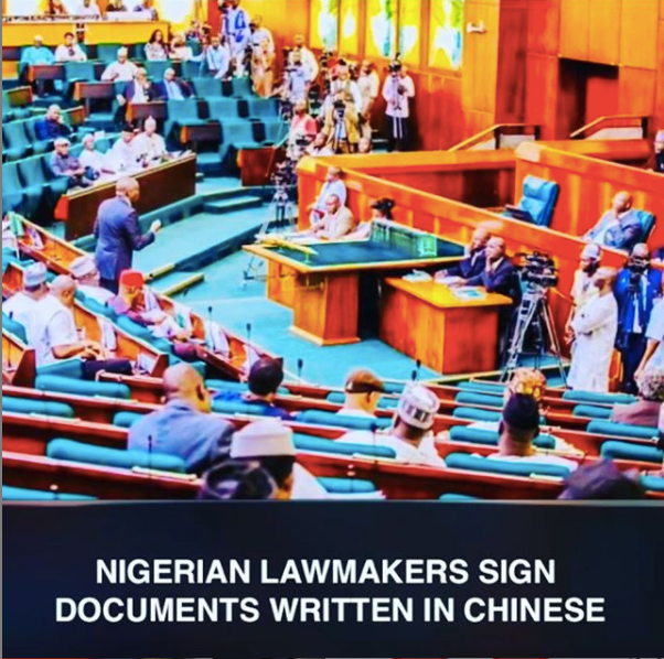 nigerian lawmakers sign documents in Chinese
