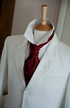 Clasic ivory suit with burgandy cravat