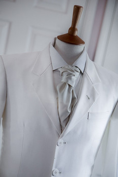 Ivory suit and silk cravat