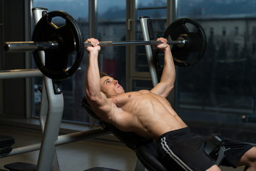 Young Man doing Incline Bench Press