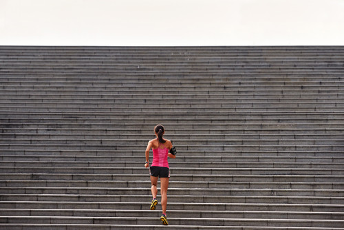 Athlete running stairs showing GRIT!
