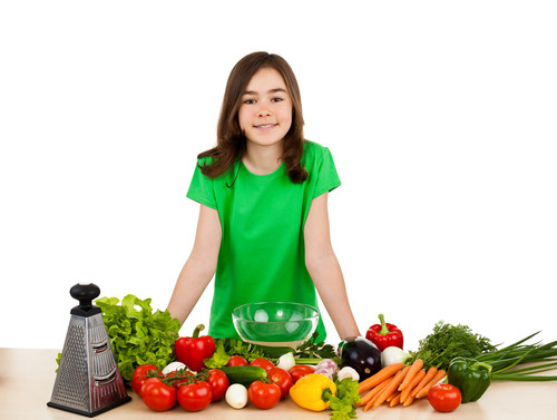 Adolescent healthy eating - Girl with vegetables