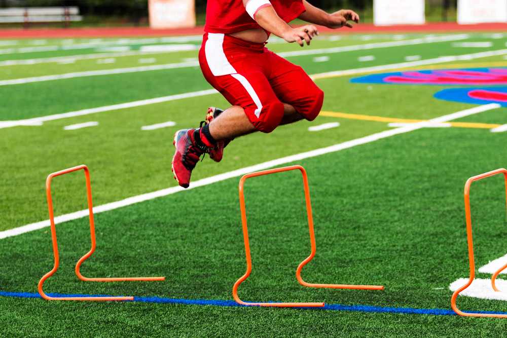 Football Player practicing with Grit
