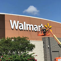 Cleaning Walmart Sign