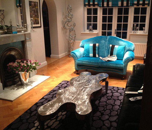 """""""Rock"""" Coffee Table and the """"Silver Women"""" sculpture"""