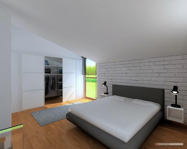 Camera da letto con parete a mattoncini