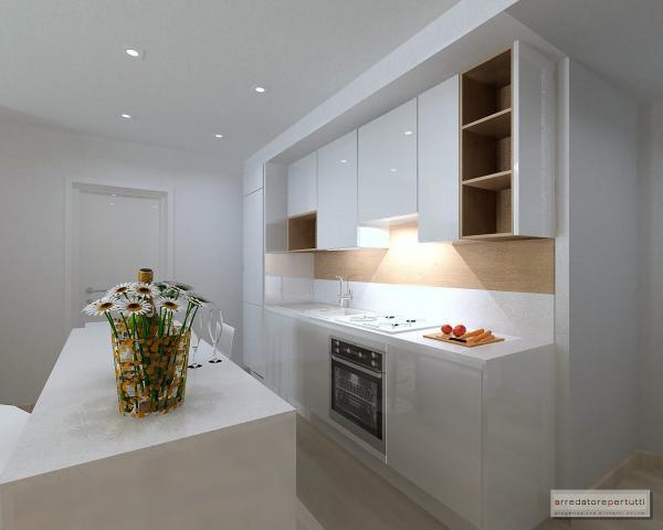 cucina con isola e tavolo