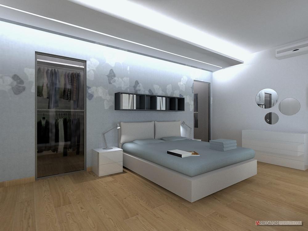 Camera ampia dove è stata creata una cabina armadio a doppia porta, una carta da parati e un gioco di luci con il cartongesso completano l'ambiente.