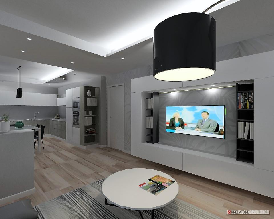 Soggiorno con parete attrezzata in un open space, particolare la carta da parati, il cartongesso funge da divisorio tra soggiorno e cucina.
