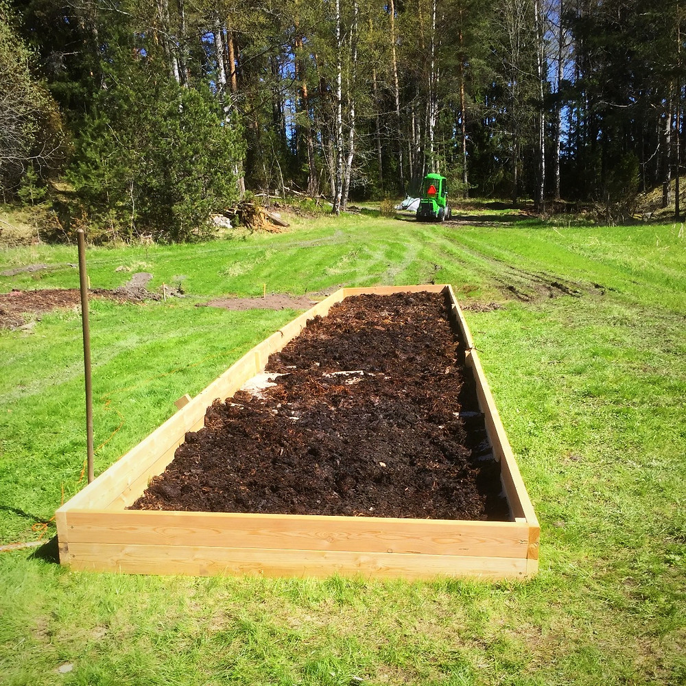 Composted cow manure at the bottom