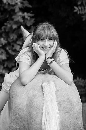 Alanna Clarke Equestrian smiling on a horse