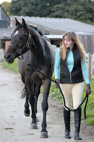 Alana Clarke Equestrian leading her horse Katrina