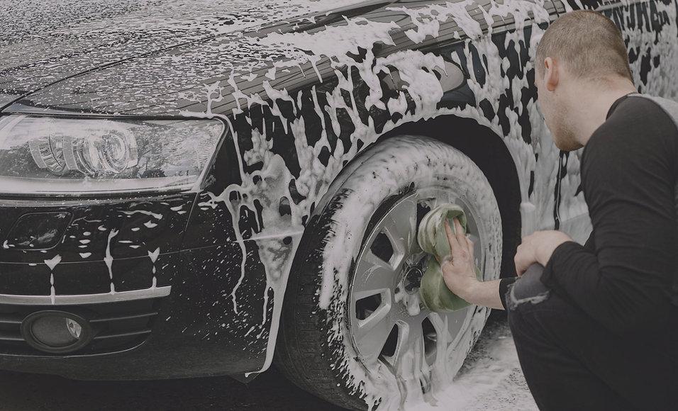 handsomen-man-black-sweater-washing-his-car_edited.jpg