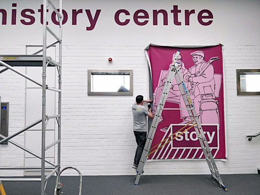 Family History Centre.....man up a ladder!