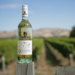 3-0%-bottle-on-post-vineyard-background.