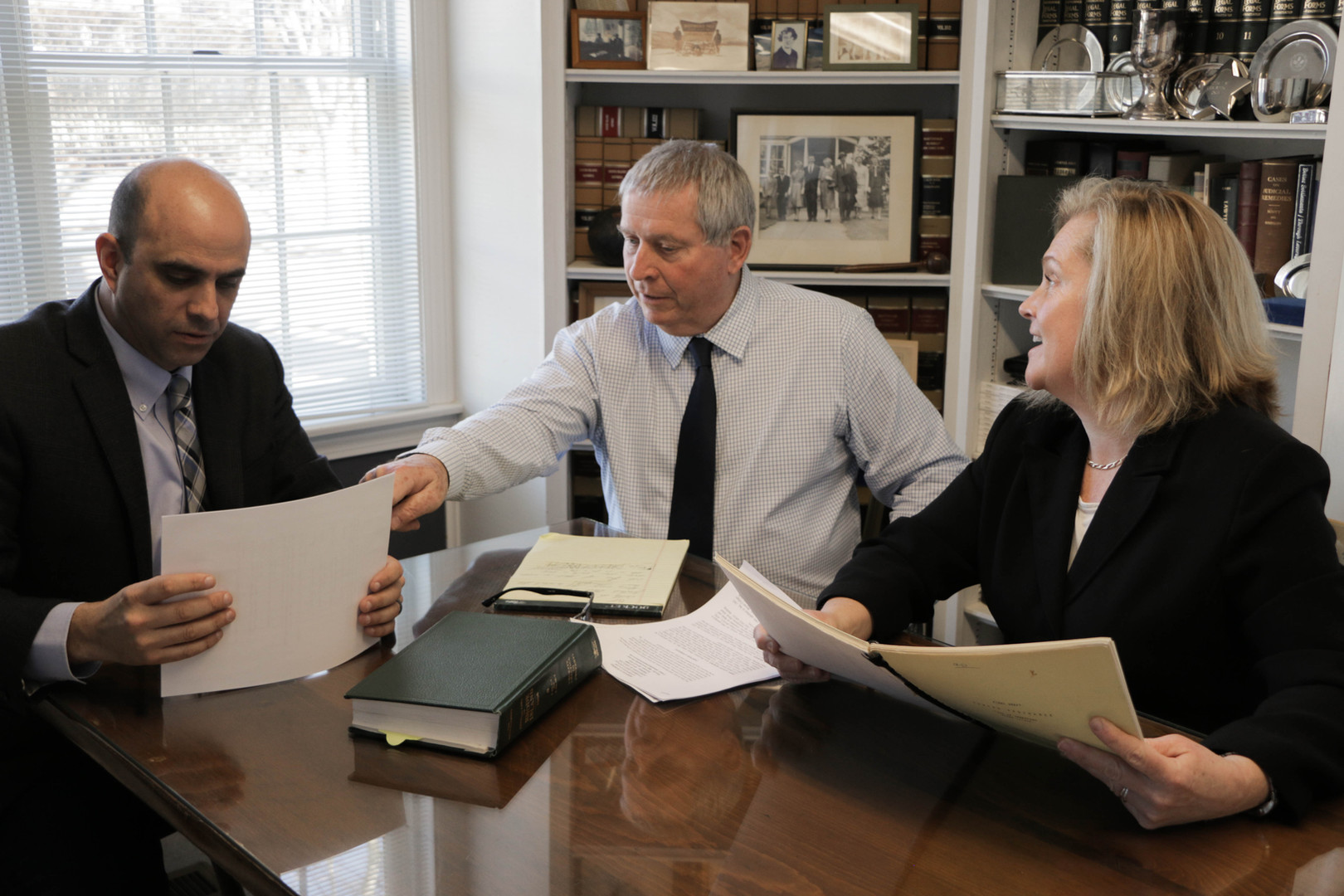 Christian S. Infantolino, John A. Murphy, and Emily J. Murphy Prior at Morneau & Murphy office in Jamest
