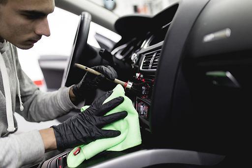 A man cleaning car interior, car detaili