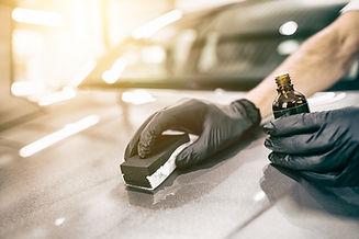 Car detailing - Man applies nano protect