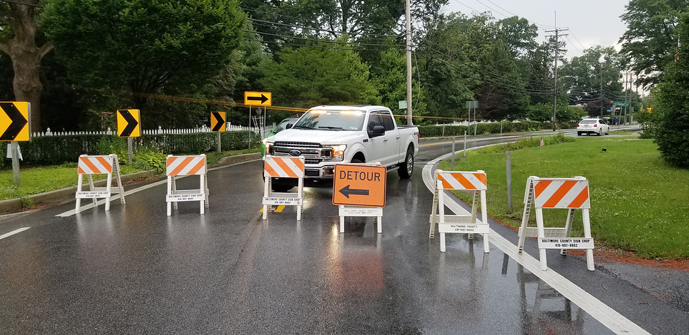 David Perry, Howard County REACT Unit 687's vehicle set up behind a barricade to direct traffic into a u-turn pattern to keep driver's away from the Catonsville Firework's parade route