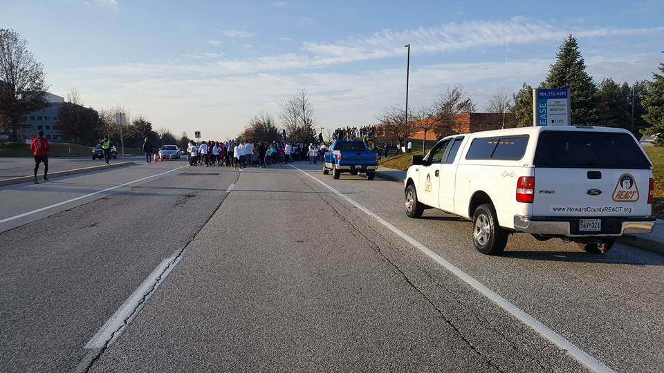 Howard County REACT member Pardeep Bhatti (Unit 621) directs event traffic into one of several parking lots available as participants line up at the start line.
