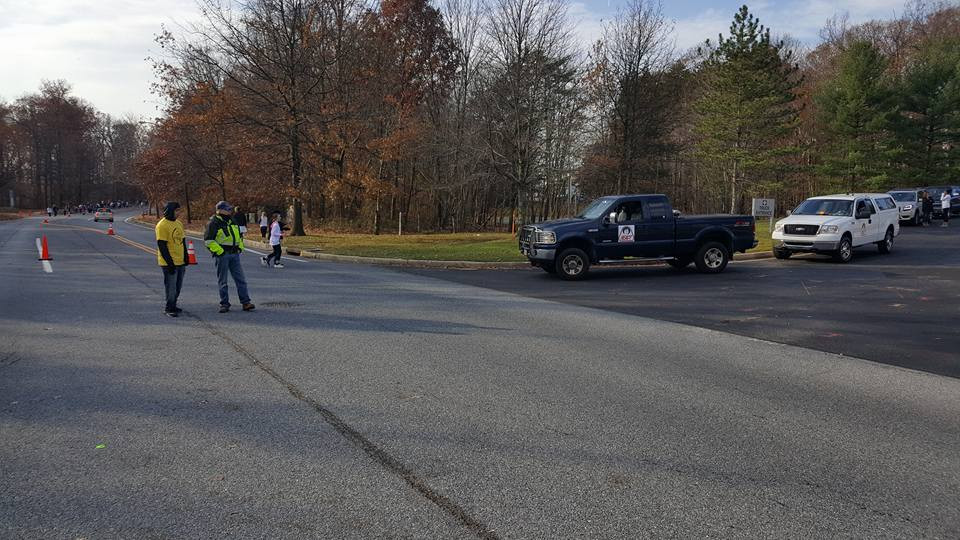 Howard County REACT member Mark Thornton (Unit 685) stands with an event volunteer at the intersection of the finish line to direct traffic into and out of the parking lots used for the event.