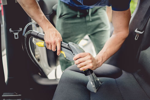 Details of car cleaning - male using pro