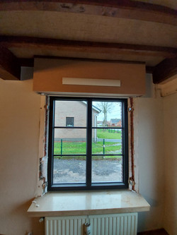 voorbeeld van raam met rolluik en transi