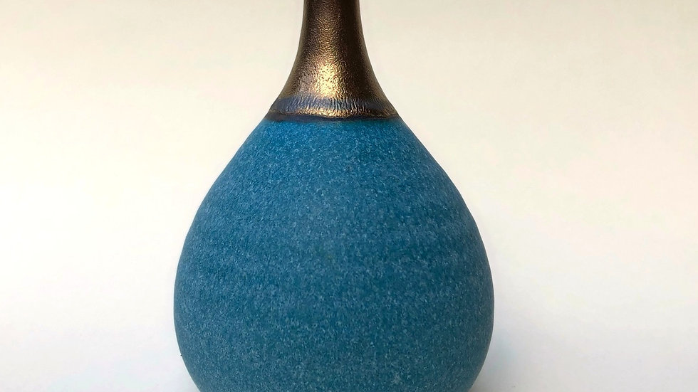 Turquoise and bronze vase