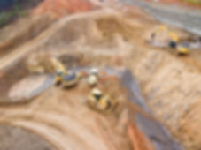 aerial photo of heavy machinery such as excavators roller and bulldozer