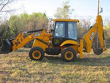 excavating excavate dig trench auger grade haul