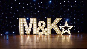 Light up letters setup in a theatre for a danceshow. 5ft light letters with 4ft star light, theatre light letters, light up letters, letter lights Glasgow, letter lights Edinburgh.
