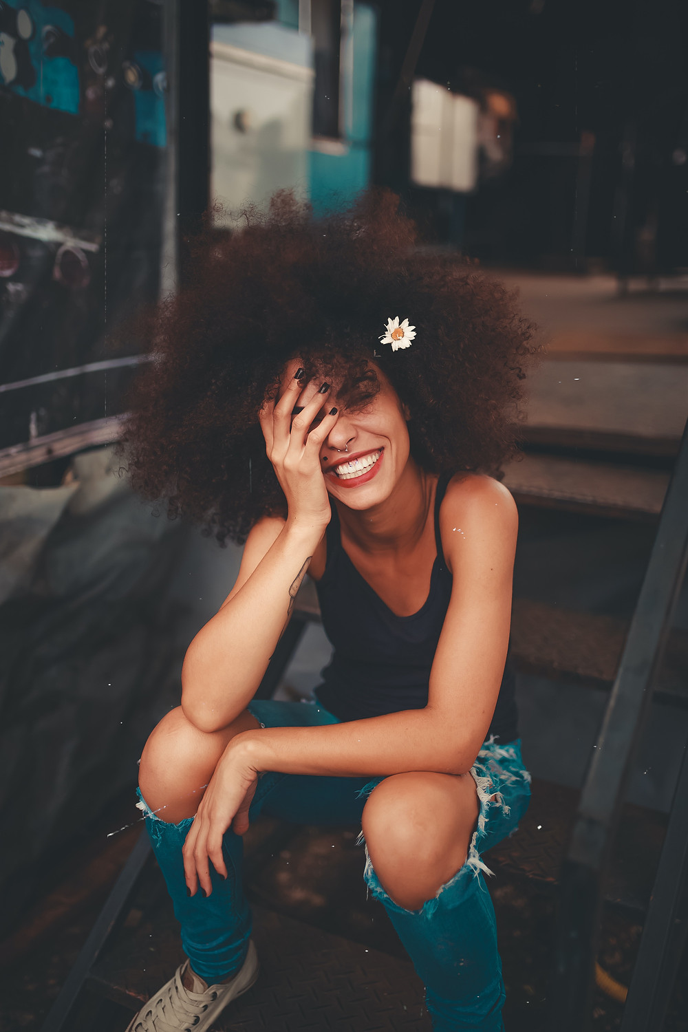 Happy young woman, smiling with her hair free.