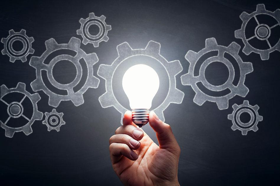 Gears---Light-Bulb-Hand-Idea-Blackboard-