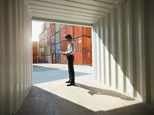 man inspecting shipping container