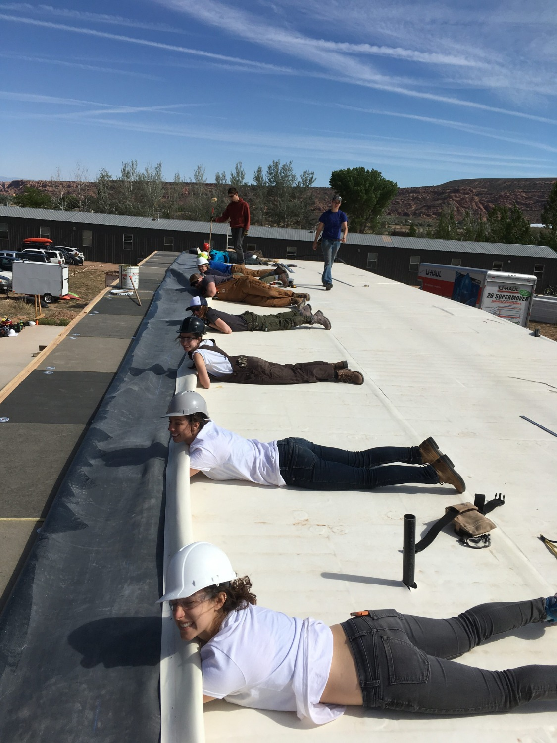 laying down epdm roof membrane