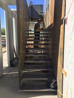 hung steel stair up to rooftop deck