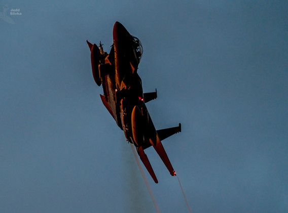"""An F-15SG Strike Eagle catches afternoon sun on a  """"flex west"""" departure from Nellis Air Force Base, Nevada."""