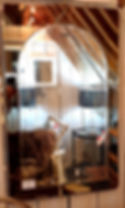 Arched mirror with tinted glass surround