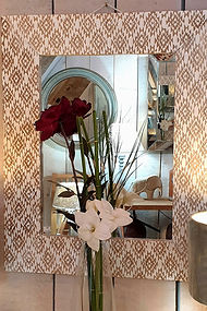 Carved wooden mirror with washed finish