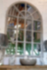 Arched window mirror with washed grey finish