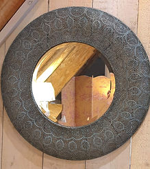 Round pierced metal mirror with verdigris finish