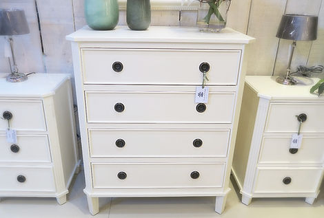 Four drawer chest of drawers in cream paint finish