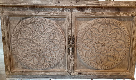 Carved cabinet with aged finish