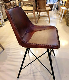 Leather covered chair shaped for comfort