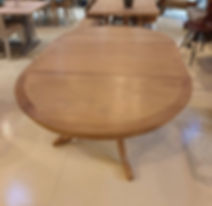 Circular Oak pedestal table with leaf inserted