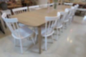Oak extending table with 2 centrally stored leaves. Seats up to 12.